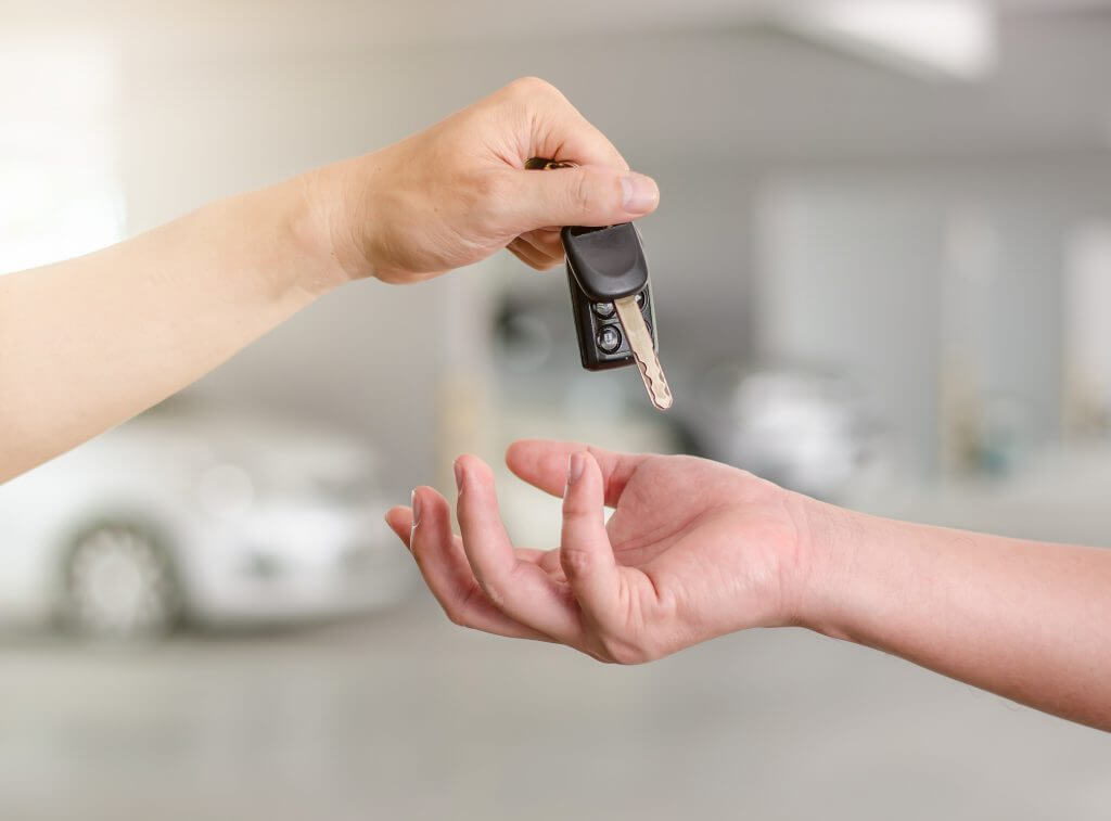 Hand passing over car key